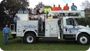 Stoughton Utilities staff gathers by their plug-in hybrid electric utility line truck.